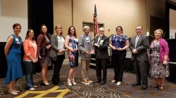 Pictured: King County Elections Operations Manager Janice Case and Director Julie Wise stand with all the award winners from this year's conference.