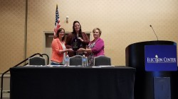 Pictured: From left, King County Elections Operations Manager Janice Case and Director Julie Wise receiving the award from an Election Center presenter.